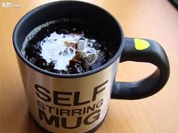 coffee mug with coffee. Delighful Coffee Self Stirring Coffee Mug On With