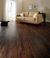 living room with beige loveseat and dark stained vinyl wood plank floor by amtico