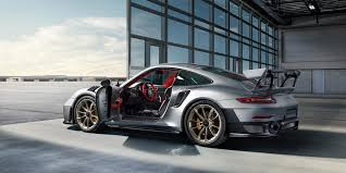 2018 porsche 911 gt2.  gt2 this time around they say it is a more comfortable and usable gt2 rs okay  porsche if anyone can render carbon fiber fixedback seats 700hp through  throughout 2018 porsche 911 gt2 1