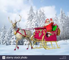 santa claus and reindeer.  Santa Santa Claus Driving A Sleigh With Reindeer On Snowy Ground To Claus And Reindeer R