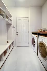 all-white mudroom laundry with open shelving