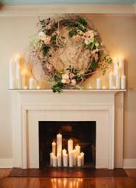 Candles in fireplace and on mantle with floral garland. A Nashville wedding  photo taken at