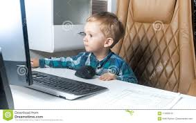 Image Barn Kids Portrait Of Cute Toddler Boy Sitting In Big Leather Office Chair And Working On Computer Dreamstimecom Portrait Of Cute Toddler Boy Sitting In Big Leather Office Chair And