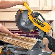 miter saw in use. compound miter saw tune up and calibration tips in use i