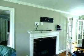 hanging tv over fireplace what to hang how high mount on wall mounting above gas stone