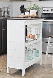 you can build this small kitchen island yourself with these free plans from ana white it not only has wheels so it can be moved around easily