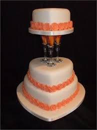 3 Tier Heart Shaped Wedding Cake Decorated With Orange Roses And