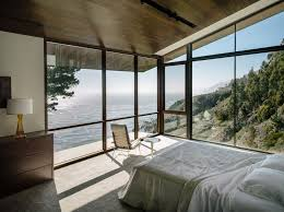 View in gallery Big Sur bedroom with a rocky beach view