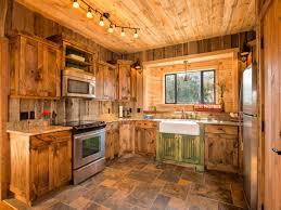 alder wood grey yardley door log cabin kitchen ideas sink faucet island concrete countertops backsplash diagonal tile stainless teel lighting flooring