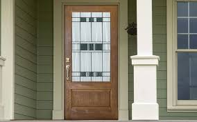an exterior door with decorative glass