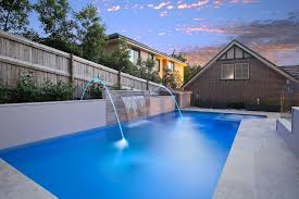inground pools with waterfalls and hot tubs. Inground Pool Water Features With Contemporary And Brick Exterior Siding Hot Tub Integrated Feature Fountain Pools Waterfalls Tubs