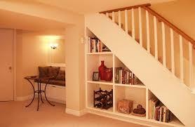 basement remodel designs.  Basement Interior Creative Basement Remodeling With Bookshelf Under The Stairs   Flooring Ideas Remodel Designs