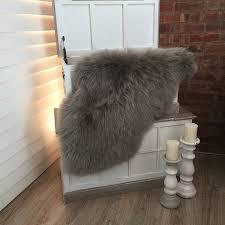 flooring sheepskin rugs ikea white rug robert abbey sconces clawfoot tub bathroom kitchen cabinets