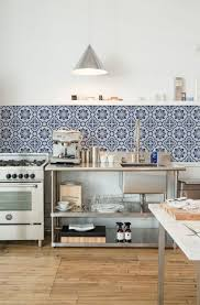 These removable large-scale sheets look like beautiful Moroccan tiles. The  blue-and-white pattern adds a welcome splash of color in a kitchen.