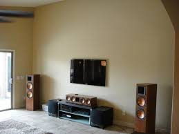 klipsch wall speakers. classic living room with wooden free standing klipsch wall speakers, tv cabinet black concrete top, and light grey shaggy area rug style speakers