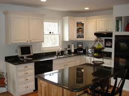 the kitchen was rebuilt with all new cabinets birch with an antique white finish recessed lighting granite countertops