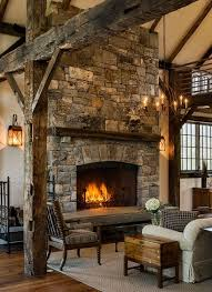 Fireplace in a stone barn addition by Crisp Architects.