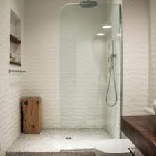 Walk-In Shower With Rippled Tile Walls and Glass Wall