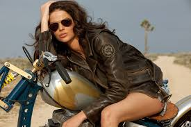 biker girl motorcycle gril of the week wearing brown leather jacket aviator