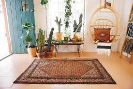 mina antique persian rug thick as thieves palm springs home decor event space