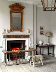 i love the mirror above the mantle as well as the gate around the fireplace for baby proofing