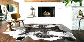 faux cowhide rug s small gold printed black and white