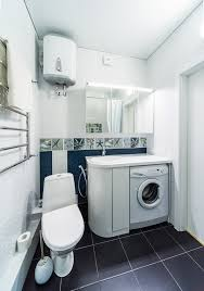 outdoor pool house bathroom that also serves as a laundry room