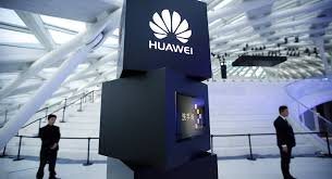 huawei logo. security personnel stand near a pillar with the huawei logo at launch event for