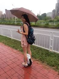 Image result for riding electric unicycle with umbrella