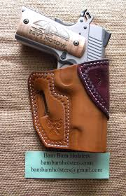 an avenger holster for a commander sized 1911 color is walnut cordovan