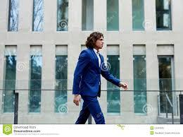 man walking to work stock photos image  stylish well dressed man walking through to work royalty stock photo
