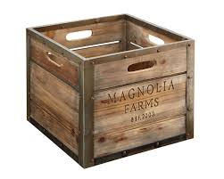 joanna s lovely magnolia farms produce crate is stained wood with aged zinc metal trim engraved with the magnolia farms logo purposeful crates perfectly