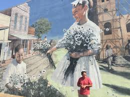 what s the story on these massive south alabama murals com wes hardin in front of his murhonoring cherry street a m e church in dothan john archibald jarchibald com