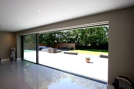 minimal windows sliding glass doors creating indoor outdoor living