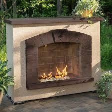 stone arch outdoor gas burning fireplace