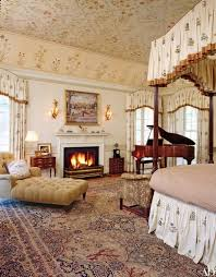at an estate in rapidan virginia decorated by tino zervudachi a botanical themed bedroom is home to an antique persian carpet the ceiling s fl motif