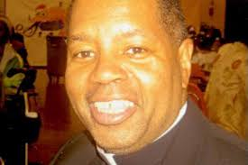Father Chester Smith dies at 60; he and his brother said to be first  African American twin priests in U.S. - Chicago Sun-Times