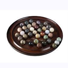 Wooden Peg Solitaire Game Wooden peg solitaire game with semi precious stone marbles A fun 68