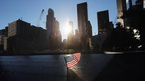 note gives new clarity on victim s death cnn a flag sits in a on the 9 11 memorial on monday