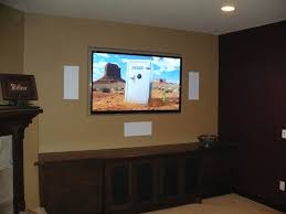 klipsch in wall speakers. simple family room area with white rectangular klipsch wall speakers, large flat screen mounted in speakers