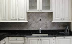black countertop ivory backsplash