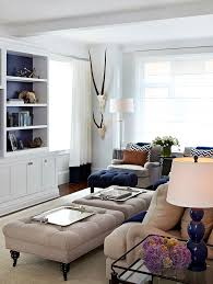 furnitures modern living room with cream tufted ottoman coffee table near white cabinet and shelves