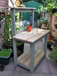 custom diy reclaimed wood potting bench with storage and hooks painted with gray chalk paint color for small backyard garden spaces ideas