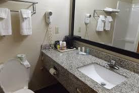 quality inn suites granite counters in bathroom