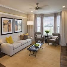 narrow living room with bay window