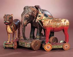 three eastern folk art carved wooden pull toys