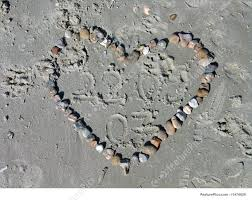love letter in the sand stock photo