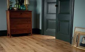 natural wood flooring in a dark room with blue green paint