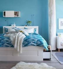 astonishing ikea bedrooms design ideas with white laminated wooden bed frame and headboard with storage shelves bedroom stunning ikea beds