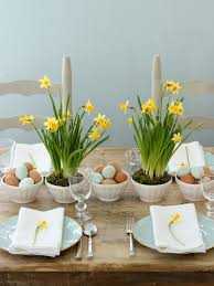 A simple tabletop with miniature daffodils in latte bowls ...